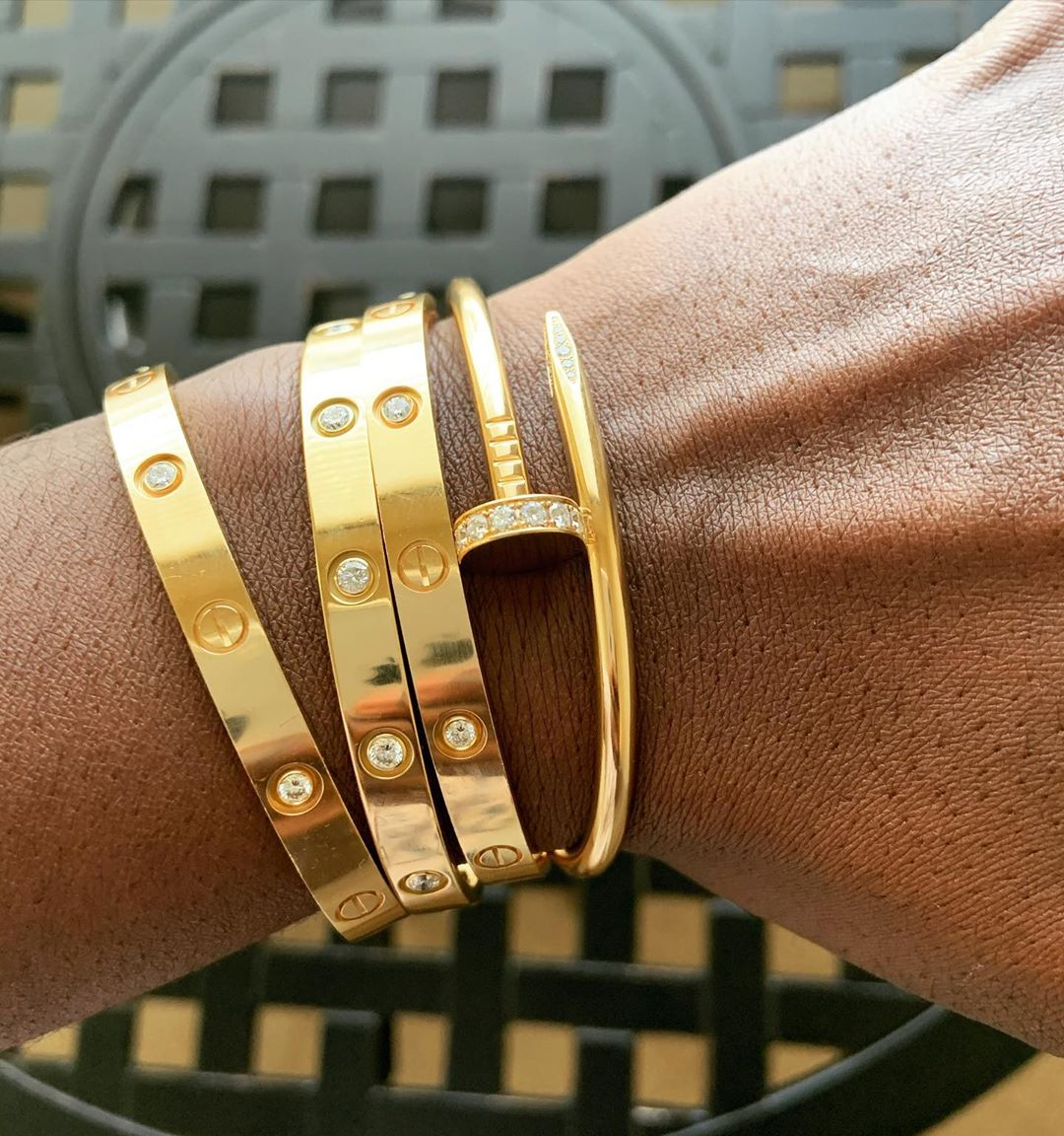 Classic Wear Stack: Cartier Love and Juste un Clou bracelet diamonds in yellow gold